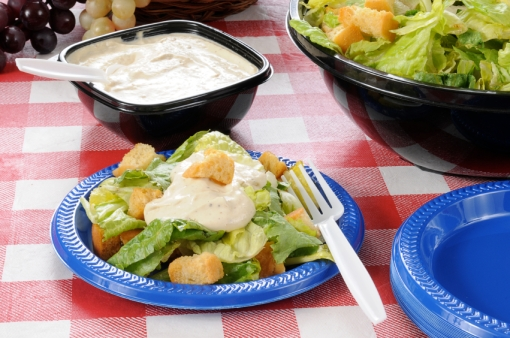 Green salad with croutons on a picnic table